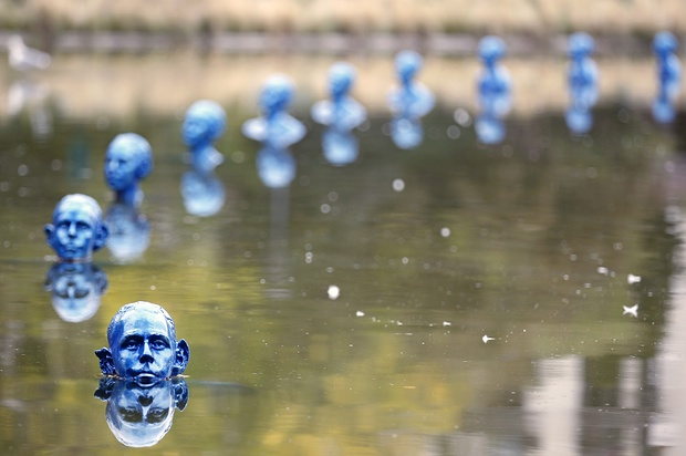 Where the Tides Ebb and Flow is an installation of 35 blue clone sculptures by Argentine artist Pedro Marzorati at the Park Montsouris in Paris, France. This artwork illustrates the theme of rising sea levels due to the global warming as part of the COP21 Paris conference next in December in Paris. Photograph: Chesnot/Getty Images