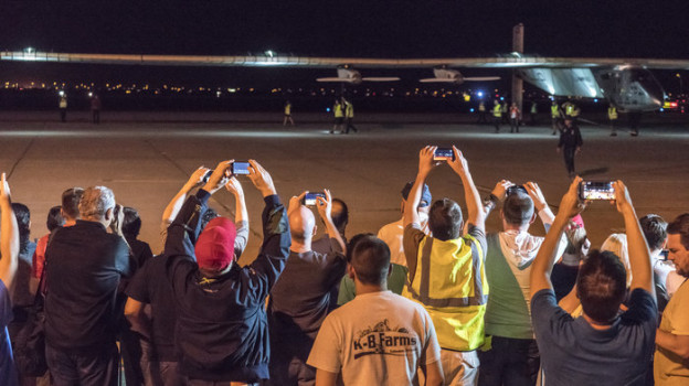 Spectators turned out to watch the Solar Impulse 2 solar airplane land at Phoenix Goodyear Airport on Monday night. Solar Impulse