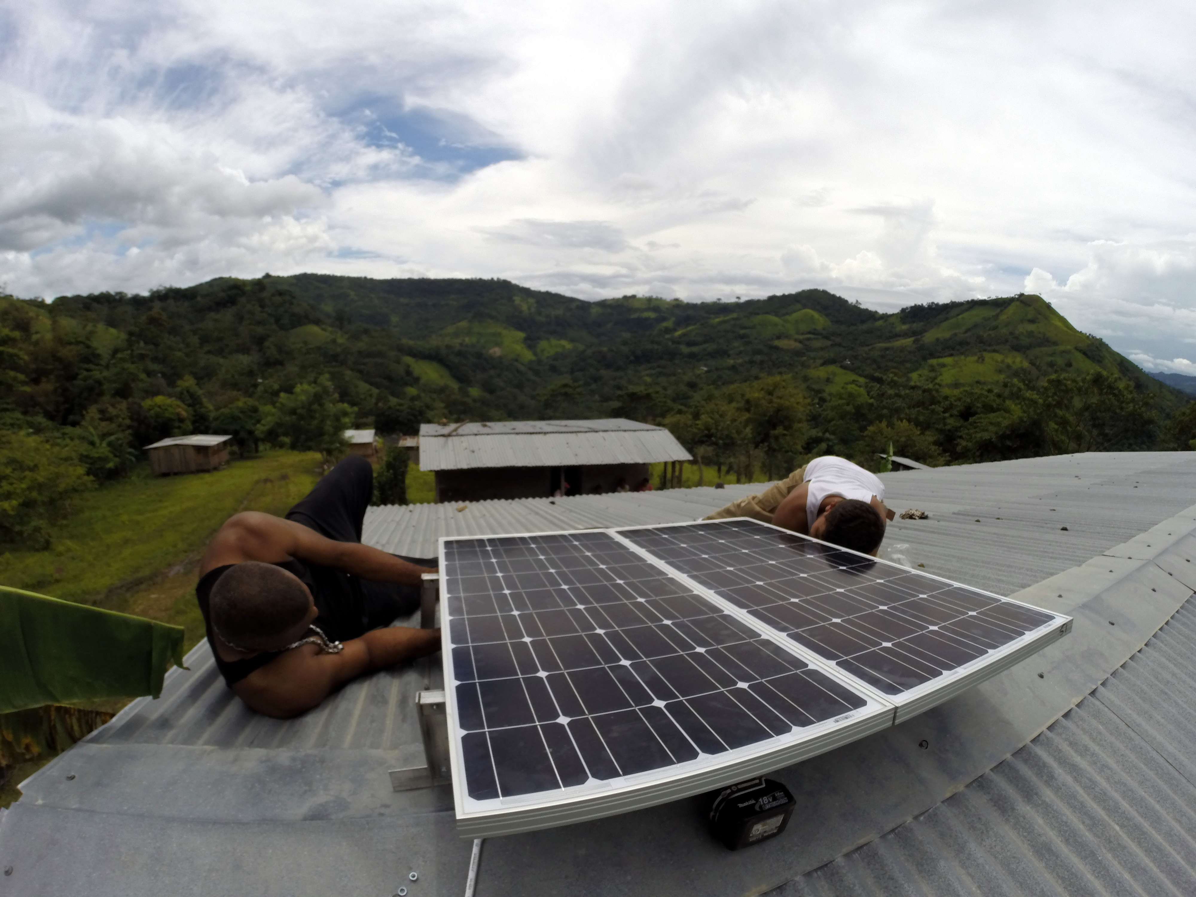 Two installers from local company Suni Solar work to set up this 250-watt PV system on a primary school in San Jose, Nicaragua.