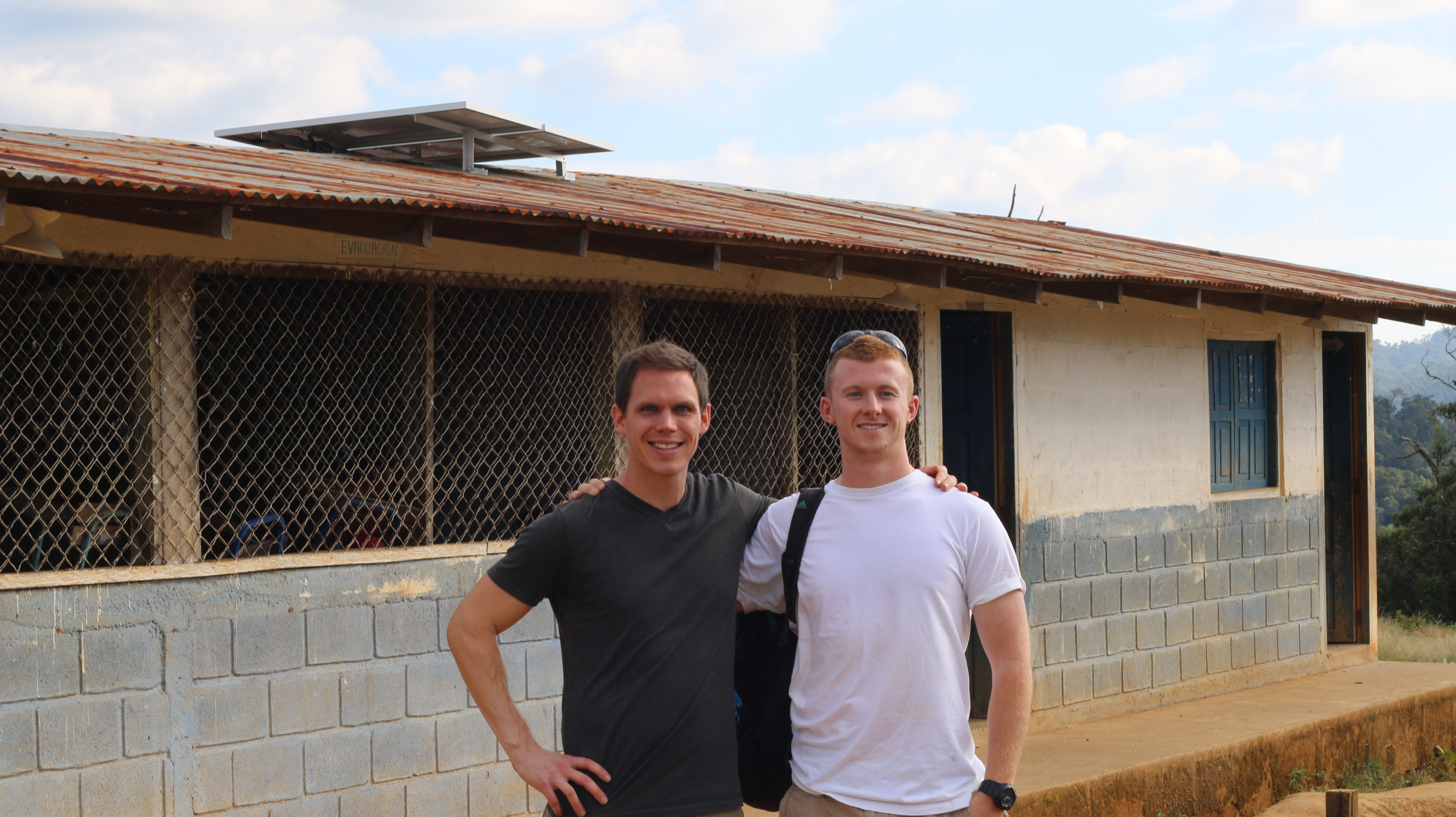Co-founder Steven Thomsen and Project Development Coordinator Charlie Egan stand in front of USI's first completed project on a primary school in Matagalpa, Nicaragua.